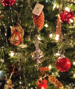 Vintage & delicate ornaments adorn the tree.  Silver icicle ornaments are used in conjunction with glass ornaments, reinforce the theme