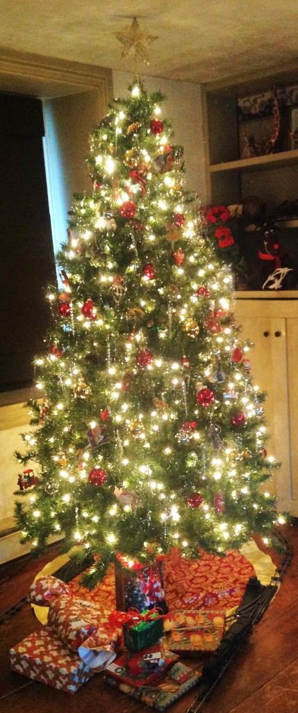 Decorated Christmas tree with lights, ornaments, & tinsel