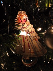 Vintage paper ornaments can be made from paper dolls & wrapping paper